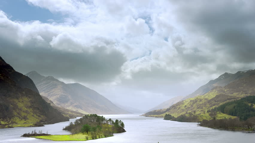 Time lapse video of Scottish highland scenery. Sunrays sweeping through the clouds. - HD stock footage clip