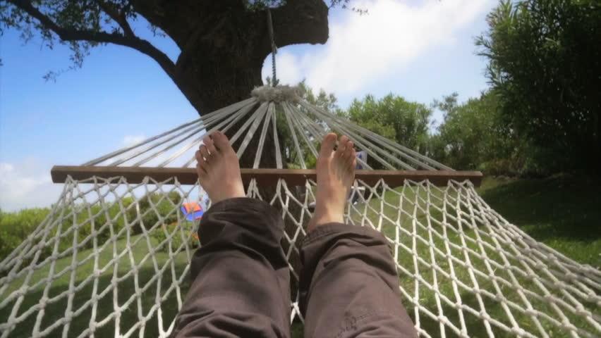 Man relaxing on the hammock in a beautiful day. Slow motion