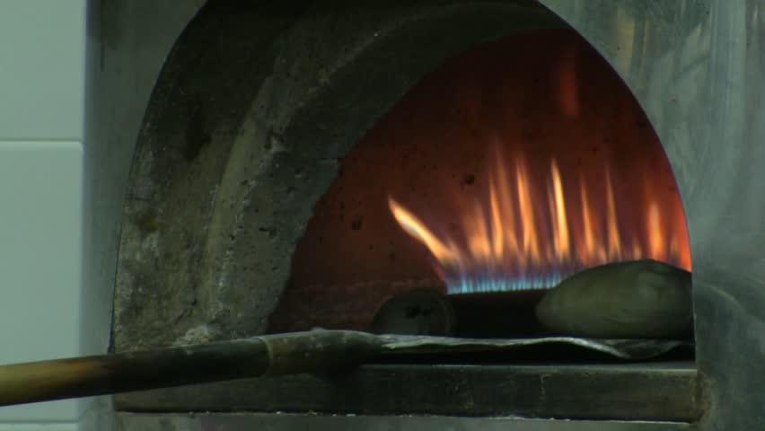 Baking Pita bread in brick oven