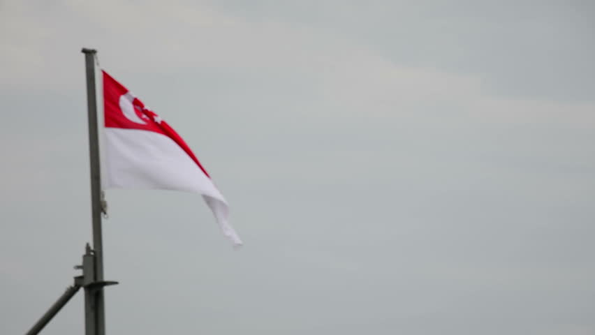 singapore flag flying on a battleship pole - HD stock footage clip