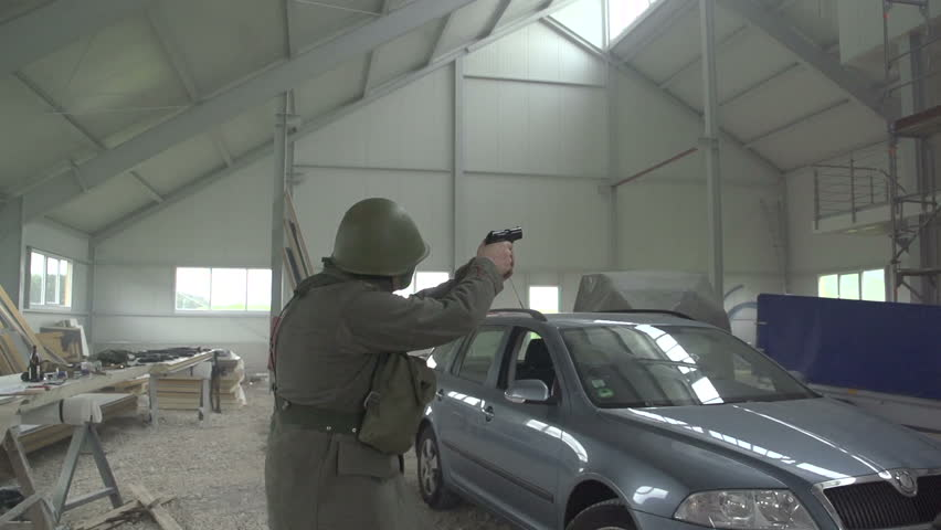 Soldier firing gun in warehouse