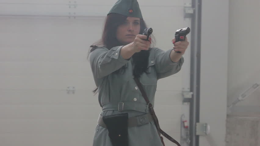 Female officer firing 2 guns