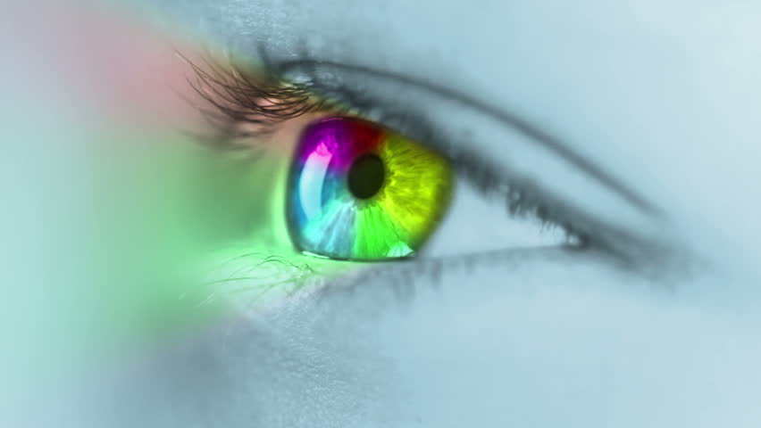 The human eye close-up. On the iris ring is rotated, colored in seven basic colors (red, orange, yellow, green, blue, indigo, violet). After blinking, rotating ring generates a multicolor light rays