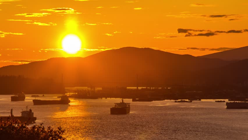 Time Lapse Sunset of Vancouver over Lion Gate Bridge and Boats in the ocean. Photo Sequence shot with DSLR Camera and Post-Production in After Effects.