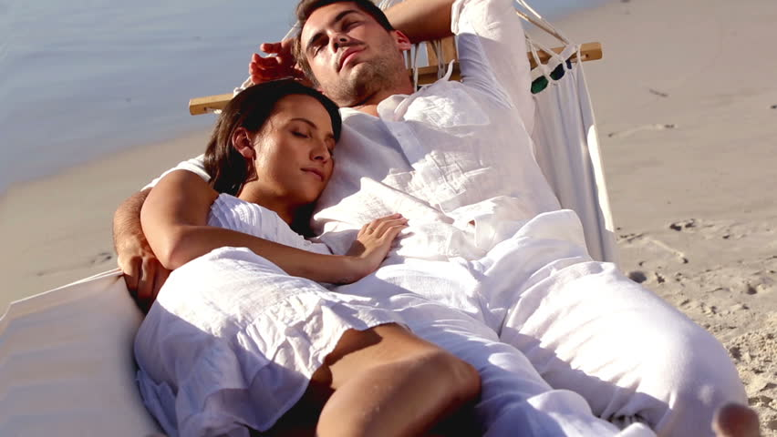 Attractive Couple Sleeping Together In A Hammock On A ...