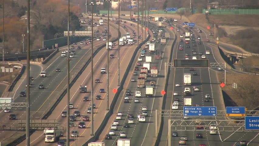 Traffic on highway 401. Longshot with heatshimmer. Toronto, Canada.  - HD stock footage clip