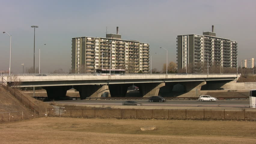 Bridge overpass and traffic on Highway 401. Toronto, Canada.  - HD stock footage clip