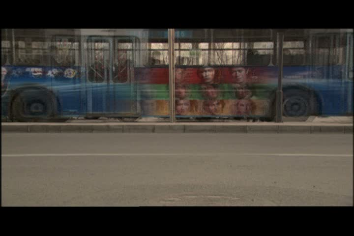 BEIJING - APRIL 01, 2004: MS sped up automobile and bicycle traffic passes left to right in front of camera. - SD stock footage clip
