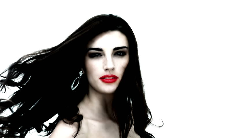 Young woman tossing her black hair on white background in slow motion - HD stock footage clip