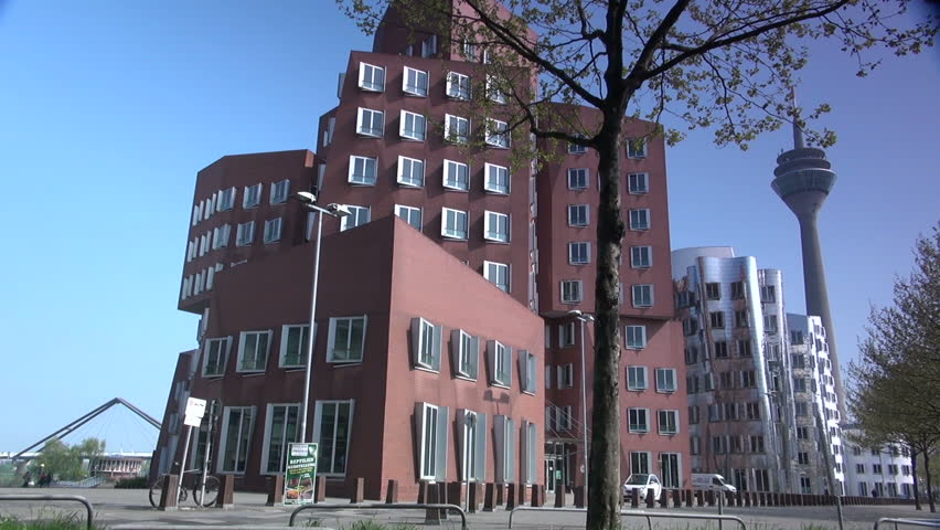 DUSSELDORF, GERMANY  May 8: Dusseldorf Harbor is home to some spectacular postmodern architecture,  with contemporary status symbols signifying corporate success: Frank Gehry.,May 8, 2013, - HD stock video clip