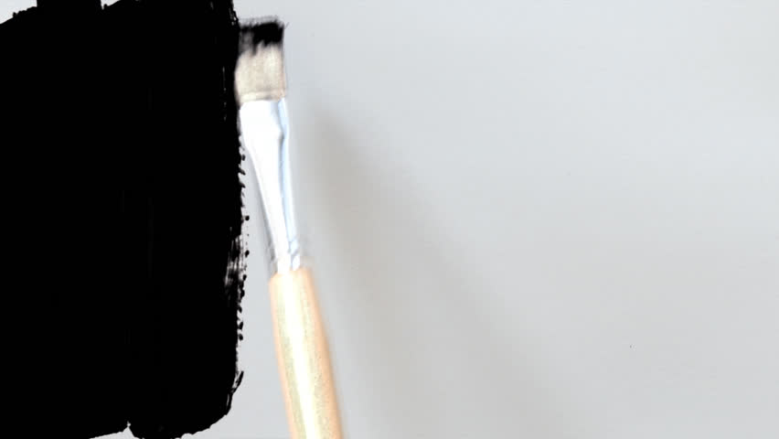 Paintbrush painting on white paper with matte