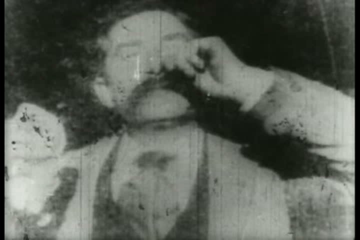 1890s - Edison kinetoscope record of a sneeze. This film was made for publicity purposes, as a series of still photographs to accompany an article in Harper's weekly. - SD stock video clip