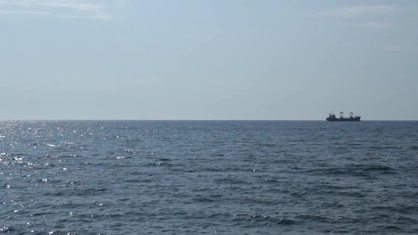 Static panorama of sea with a ship. Canon 600D + Sigma 17-50/2.8, 23.976 fps. - HD stock footage clip
