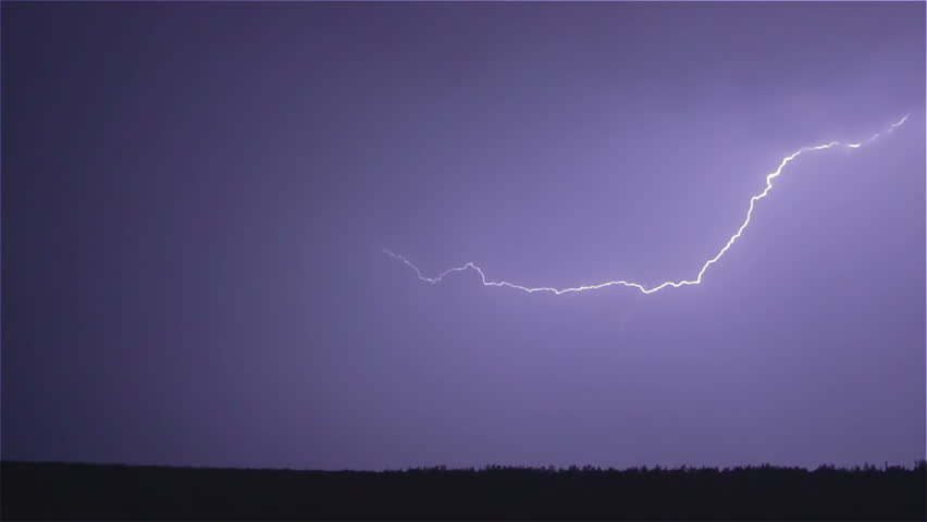 Various lightning bolts strike forest night landscape, sound included - HD stock footage clip