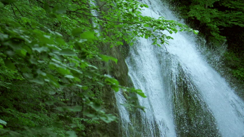 waterfall in mountains in slow motion, high speed reel. super slow motion dolly