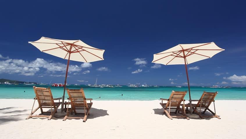 Sun umbrellas and chaise longues on caribbean beach with for Beach chaise longue
