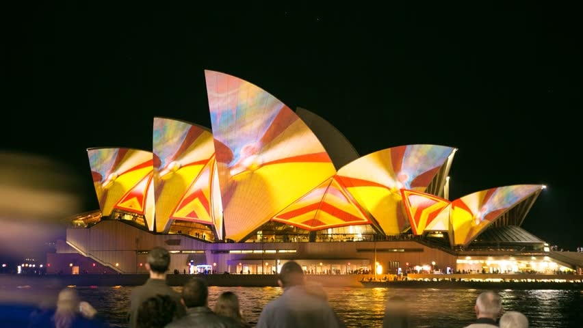 SYDNEY, NSW/AUSTRALIA - JUNE 10, 2013 - Sydney Opera House is illuminated by a projection for the Vivid Lights Festival. This is a time lapse clip.