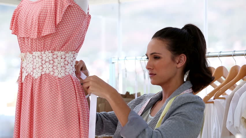 Hispanic Woman At Work As Fashion Designer And Tailor