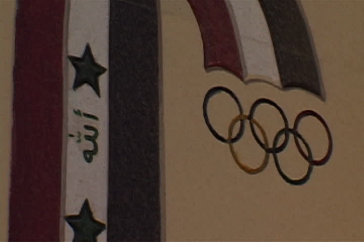 BAGHDAD, IRAQ - JULY 26, 2003: Logo on the side of the bombed Iraqi National Olympic Headquarters.