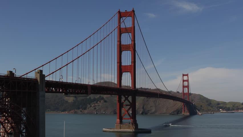 Famous Golden Gate Bridge, San Francisco Bay Skyline, California, Boat Ship Cars Traffic - HD stock video clip