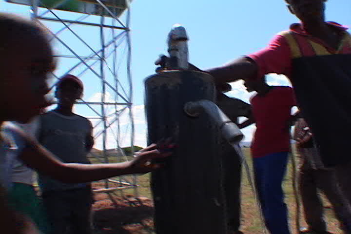 EASTERN CAPE, SOUTH AFRICA - OCTOBER 01, 2005: Boys take turns drinking and washing their hands at new village water pump. - SD stock video clip