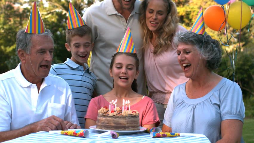 Happy family celebrating a birthday and clapping hands in slow motion - HD stock video clip