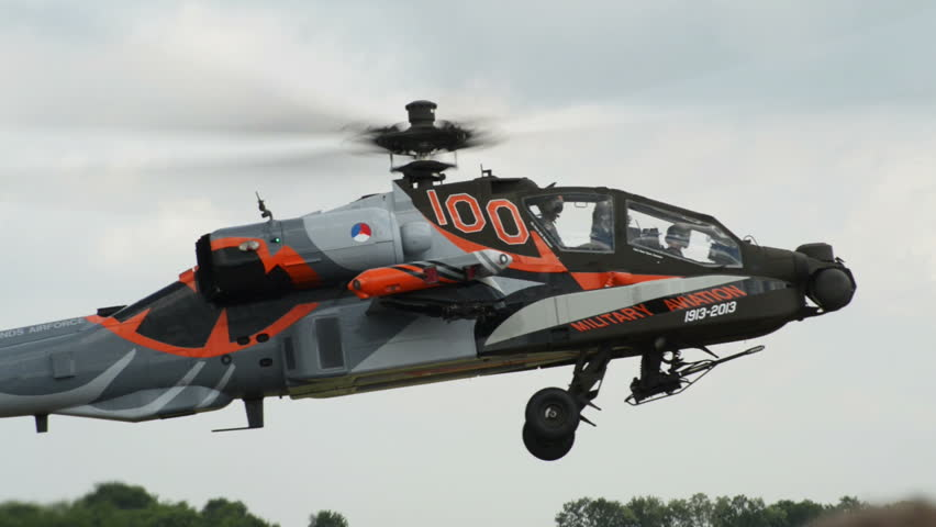 VOLKEL, NETHERLANDS - June 14 2013: An Apache AH-64 Helicopter lift off during an airshow at Volkel, Netherlands, June 14, 2013