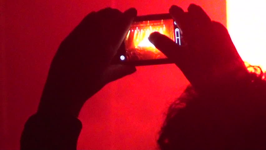 Boy records the concert with his smartphone