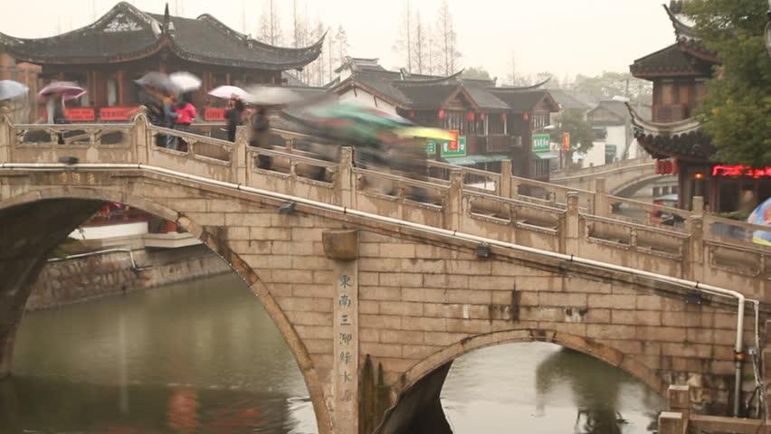 SHANGHAI - DECEMBER 16: Qibao Ancient Town traditional bridge on rainy day,