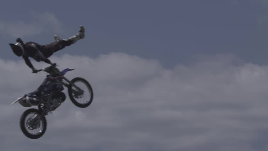 Motocross Jumper Doing Crazy Tricks on a Cloudy Sky Background - HD stock footage clip