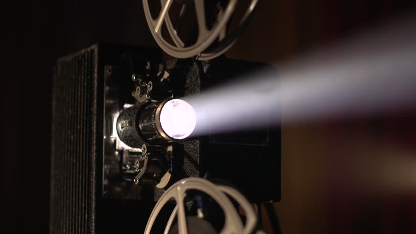 Film projector dolly shot, then white out, slow motion close - HD stock footage clip