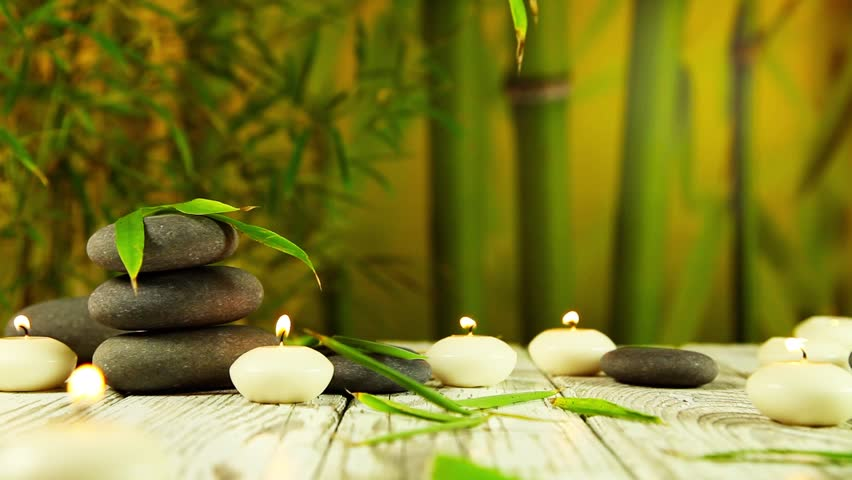 Spa Scene With Zen Rocks And Candle Against Bamboo