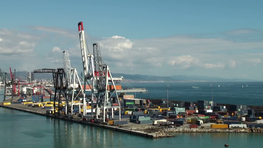 CASABLANCA, MOROCCO - MARCH 12, 2011: Crane spreaders and containers from a ship leaving the harbor of Casablanca, one of the biggest ports in the world