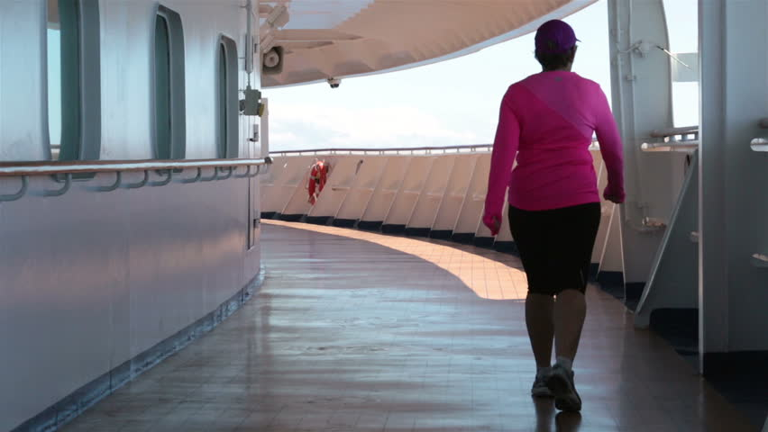 PACIFIC OCEAN, ALASKA MAY 2013: Woman walking for exercise cruise ship deck. Princess cruise ship participated in organized Susan G Komen breast cancer walk. Great exercise recreation for passengers. - HD stock footage clip