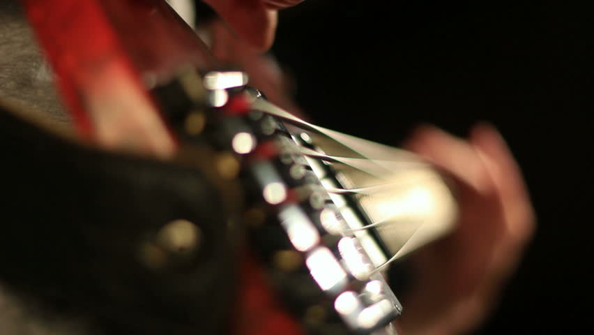 Close-up of hands of a bass guitar player. Find similar clips in our portfolio. | Shutterstock HD Video #4169263