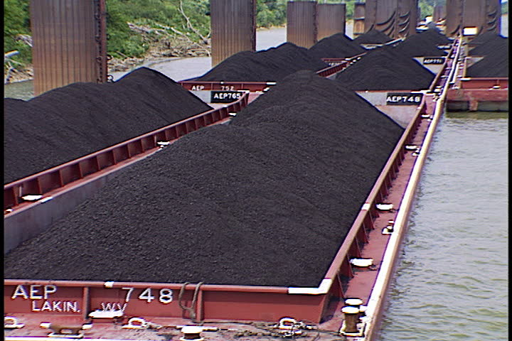 Cluster of coal barges heaped with coal in Metropolis, Illinois.