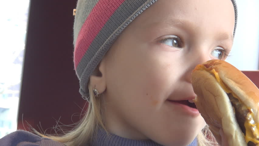 Child Eating Hamburger at Restaurant, Closeup of Hungry Girl Eating Fastfood - HD stock video clip