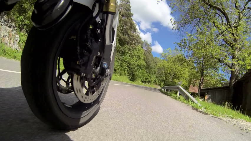 Motorcycle view from the front wheel - HD stock footage clip