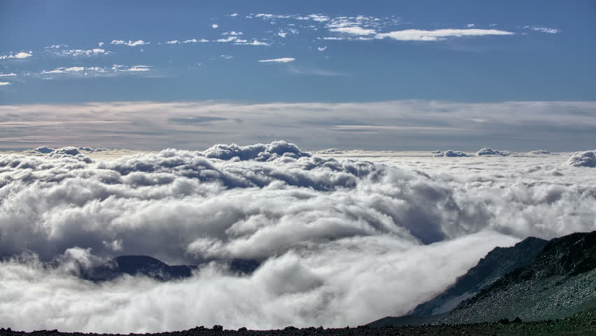 Clouds sliding into mountain vortex time lapse - HD stock footage clip