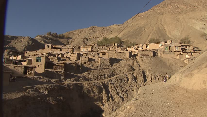 Man on Donkey approaching an unnamed village in the upper Yaftal region in far north east of Afghanistan. Shot in October 2011 - HD stock footage clip