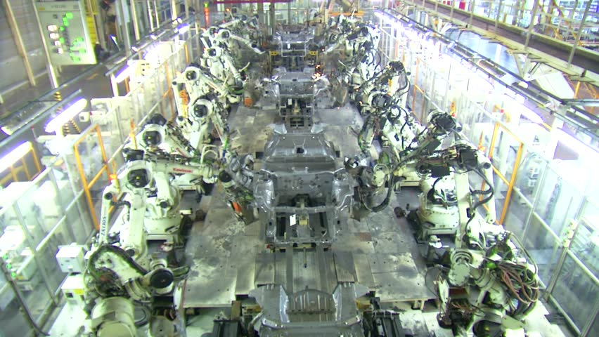 Robots are welding in automobile factory