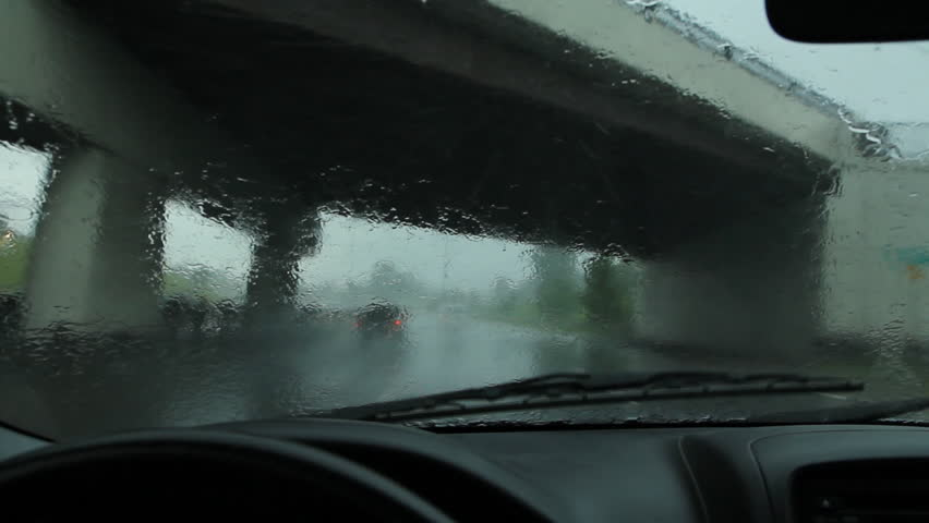 Approaching Toronto from the west on the QEW highway. Heavy rain falling.
