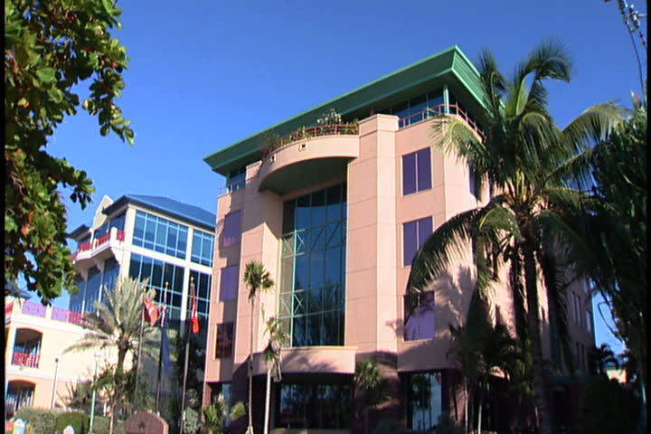 GRAND CAYMAN, CAYMAN ISLANDS - DECEMBER 11, 2003: Tilt down Queensgate House, an office building housing offshore headquarters for international businesses.