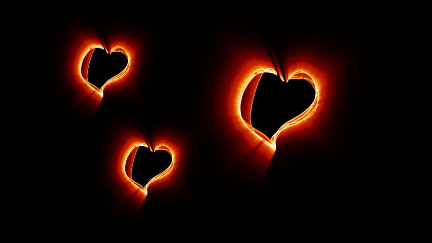 Three bouncing heart shapes made of fire-like glowing lines.  Clip created by recording live action glowing strands which have been rotoscoped in After Effects and filters added.