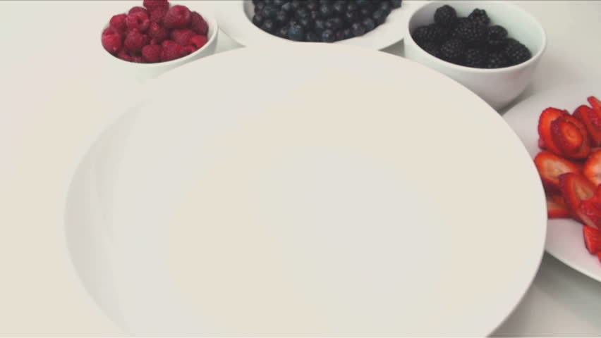 1920x1080 Chef tosses strawberries, blackberries, blueberries and raspberries into bowl, sprinkles sugar, tosses into delectable desert. - HD stock footage clip