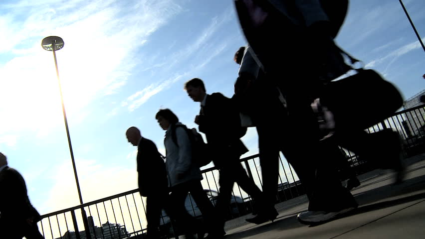 Silhouettes of city commuters in slow motion - HD stock footage clip
