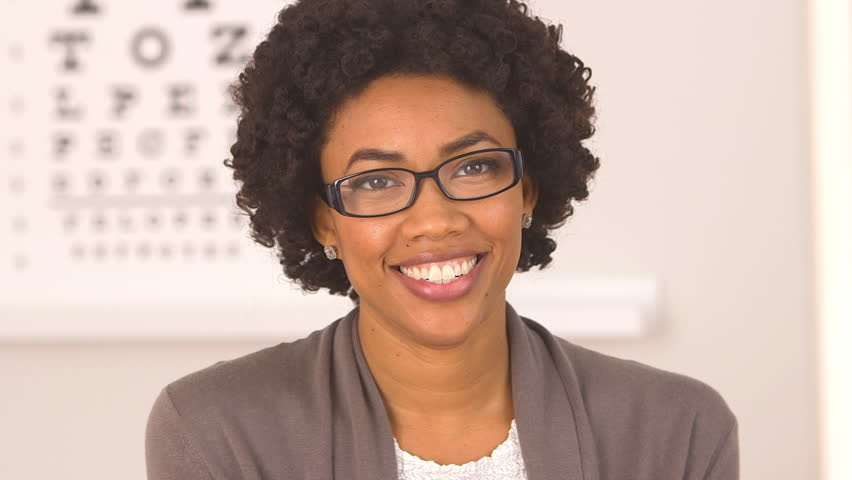 African American woman happy with new glasses at eye doctor - HD stock footage clip