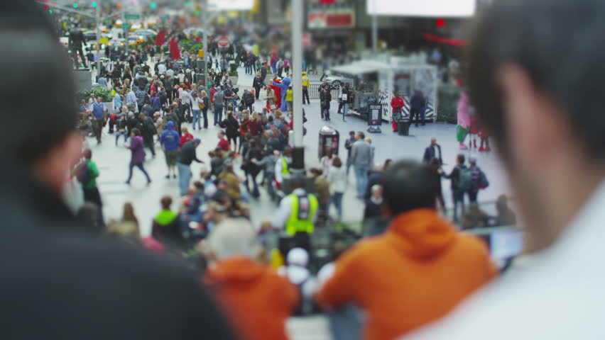 Crowds of tourists gather at Times Square in New York City. - HD stock footage clip