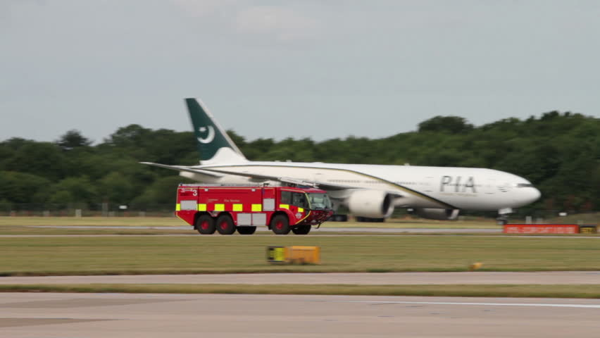 MANCHESTER, LANCASHIRE/ENGLAND - JULY 30: Pan of emergency fire truck at Manchester Airport on July 30, 2013 in Manchester.