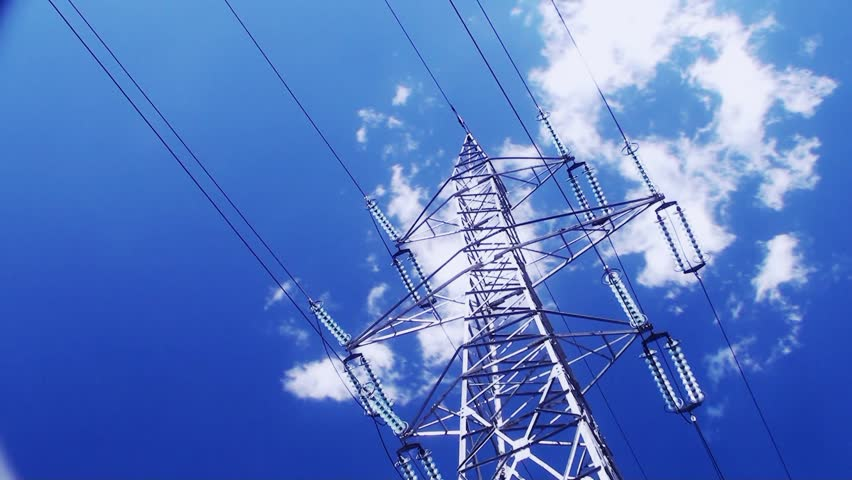 High voltage tower on cloudy sky in time lapse motion - HD stock video clip